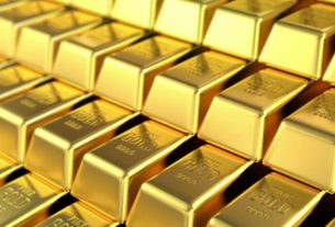 Gold edges up on fears about second wave of infections