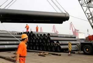 China's factory activity expands, but job losses quicken amid weak exports